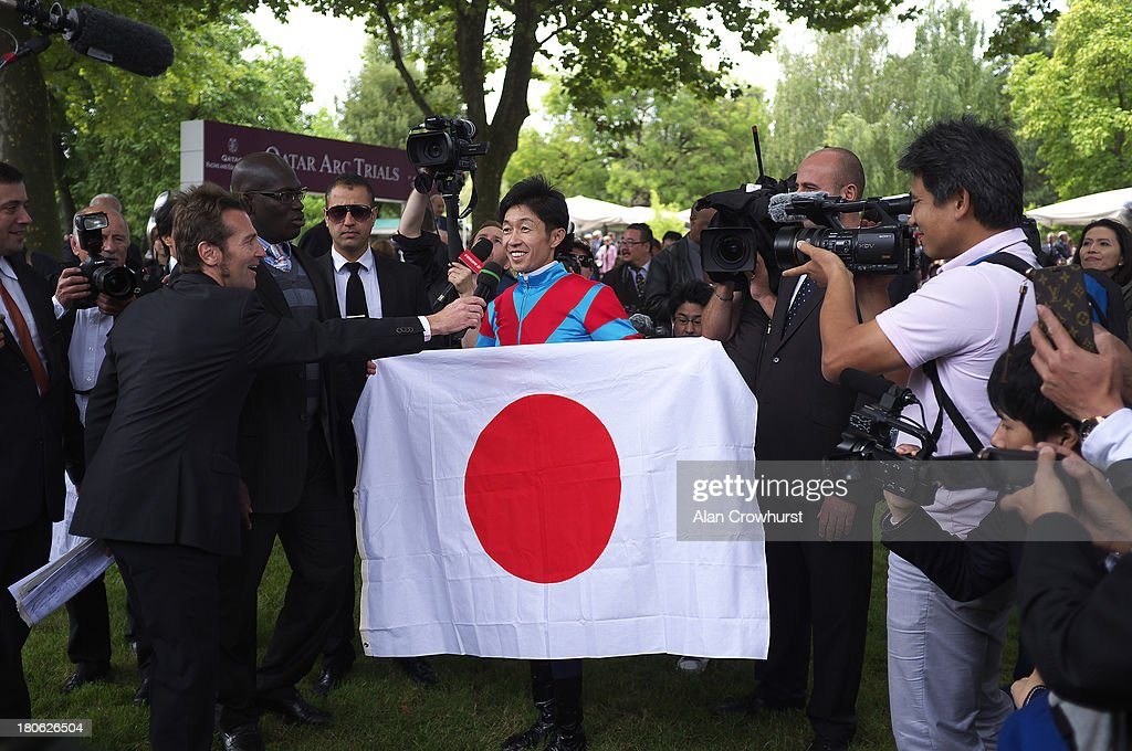 Yutaka Take with the Japanese flag at Longchamp racecourse on September 15, 2013 in Paris, France.