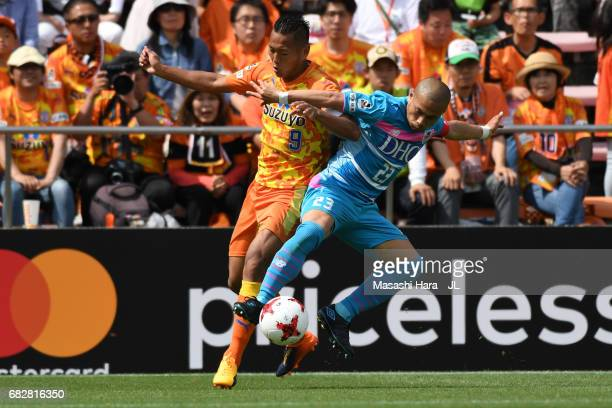 Yutaka Yoshida of Sagan Tosu and Chong Tese of Shimizu SPulse compete for the ball during the JLeague J1 match between Shimizu SPulse and Sagan Tosu...