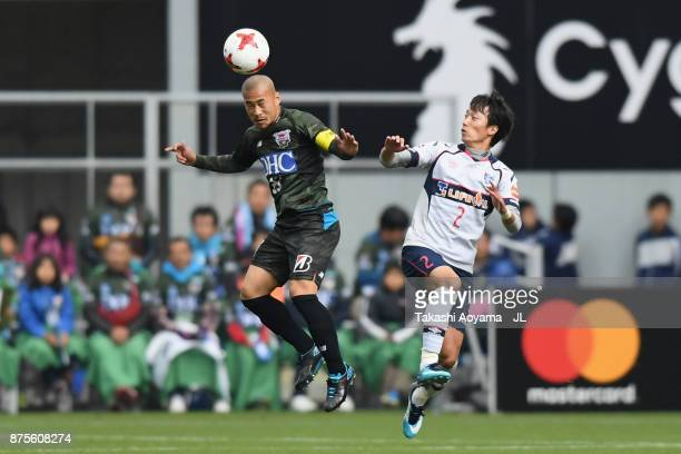 Yutaka Yoshida of Sagan Tosu and Sei Muroya of FC Tokyo compete for the ball during the JLeague J1 match between Sagan Tosu and FC Tokyo at Best...