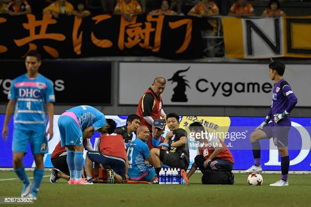 Yutaka Yoshida of Sagan Tosu looks on after picking up an injury during the JLeague J1 match between Sagan Tosu and Shimizu SPulse at Best Amenity...