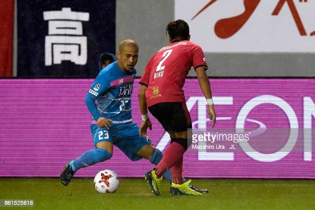 Yutaka Yoshida of Sagan Tosu takes on Riku Matsuda of Cerezo Osaka during the JLeague J1 match between Sagan Tosu and Cerezo Osaka at Best Amenity...