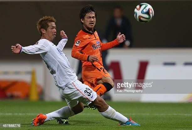 Yutaka Yoshida of Shimizu SPulse and Tsukasa Shiotani of Sanfrecce Hiroshimacompete for the ball during the JLeague match between Shimizu SPulse and...