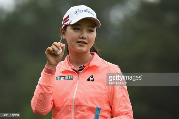 Yuting Seki of China acknowledges the crowd before her tee shot on the 10th hole during the first round of the HokennoMadoguchi Ladies at the Fukuoka...