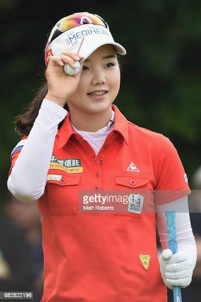 Yuting Seki of China acknowledges the crowd before her tee shot on the 10th hole during the final round of the HokennoMadoguchi Ladies at the Fukuoka...