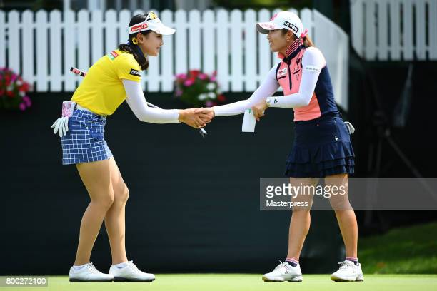Yuting Seki of China and BooMee Lee of South Korea shake hands on the 18th hole during the third round of the Earth Mondamin Cup at the Camellia...