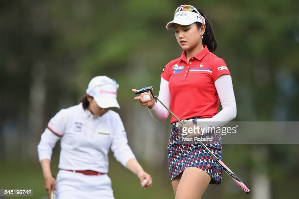Yuting Seki of China reacts after her putt on the 1st green during the final round of the 50th LPGA Championship Konica Minolta Cup 2017 at the Appi...