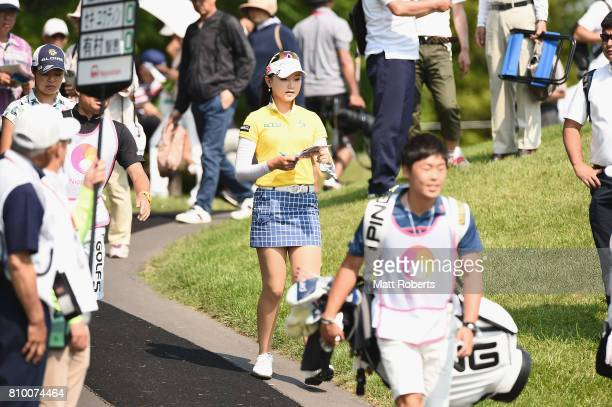 Yuting Seki of China walks to the first tee during the first round of the Nipponham Ladies Classics at the Ambix Hakodate Club on July 7 2017 in...