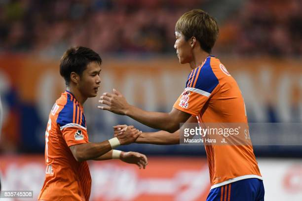 Yuto Horigome of Albirex Niigata is replaced by Song Ju Hun during the JLeague J1 match between Albirex Niigata and Vegalta Sendai at Denka Big Swan...