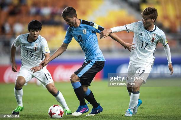 Yuto Iwasaki of Japan and Mizuki Ichimaru of Japan challenges Rodrigo Bentancur of Uruguay during the FIFA U20 World Cup Korea Republic 2017 group D...