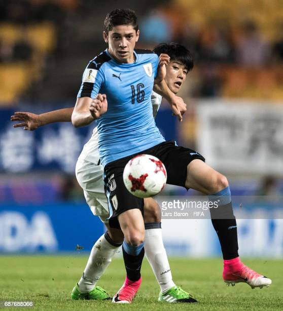 Yuto Iwasaki of Japan challenges Federico Valverde of Uruguay during the FIFA U20 World Cup Korea Republic 2017 group D match between Uruguay and...
