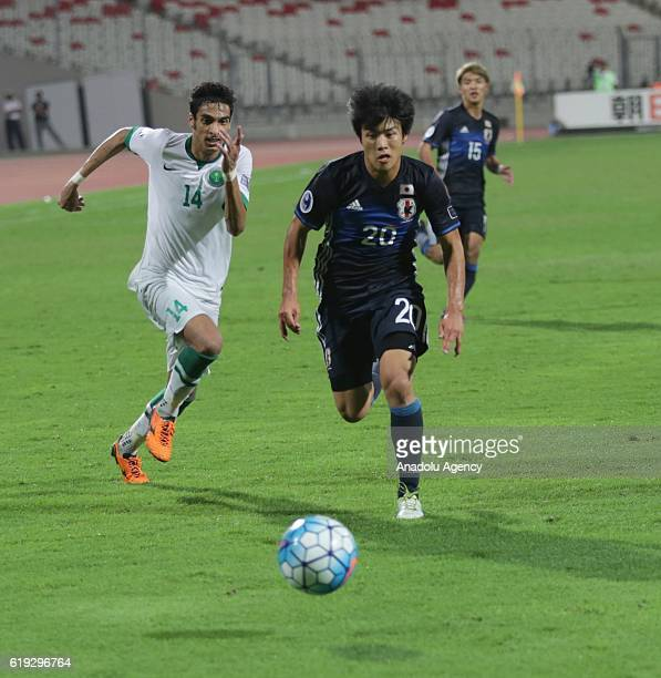 Yuto Iwasaki of Japan in action during the Asian Under19 Championship football match between Japan and Saudi Arabia at the National Stadium in Manama...