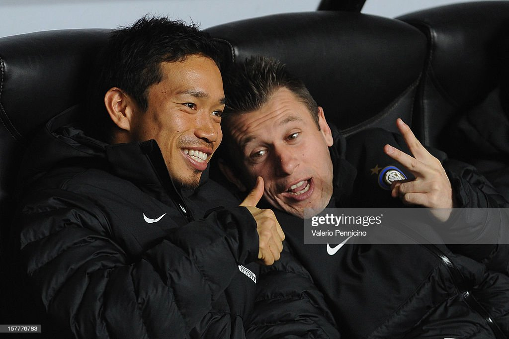 Yuto Nagatomo (L) and Antonio Cassano of FC Internazionale Milano sit on the bench prior to the UEFA Europa League group H match between FC Internazionale Milano and Neftci PFK on December 6, 2012 in Milan, Italy.