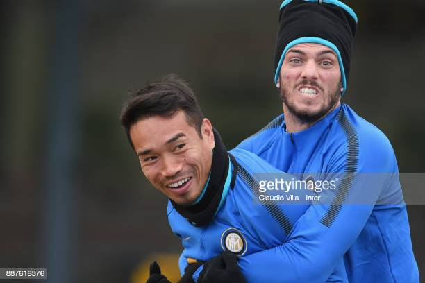 Yuto Nagatomo and Davide Santon of FC Internazionale joking during an FC Internazionale training session at Suning Training Center at Appiano Gentile...