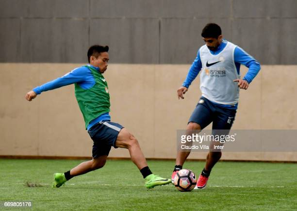 Yuto Nagatomo and Ever Banega of FC Internazionale compete for the ball during FC Internazionale training session at Suning Training Center at...
