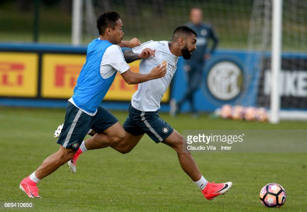 Yuto Nagatomo and Gabriel Barbosa Almeida compete for the ball during FC Internazionale training session at Suning Training Center at Appiano Gentile...