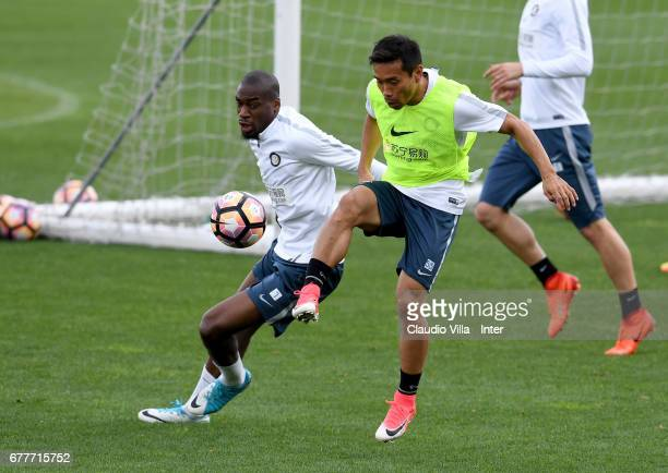 Yuto Nagatomo and Geoffrey Kondogbia of FC Internazionale compete for the ball during FC Internazionale training session at Suning Training Center at...