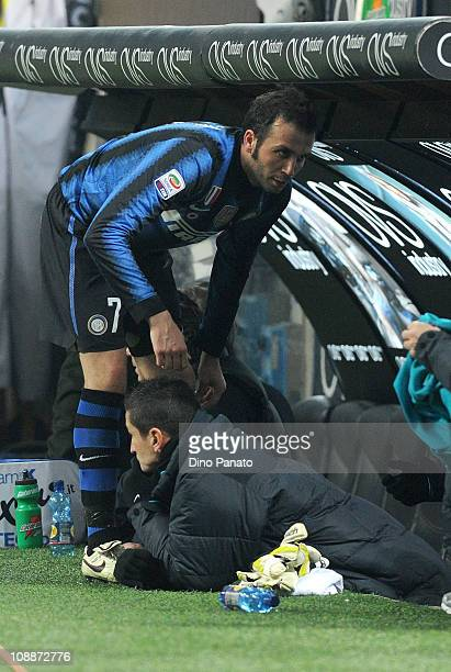 Yuto Nagatomo and Giampaolo Pazzini of Inter Milan looks on from the bench during the Serie A match between F C Internazionale Milano and AS Roma at...