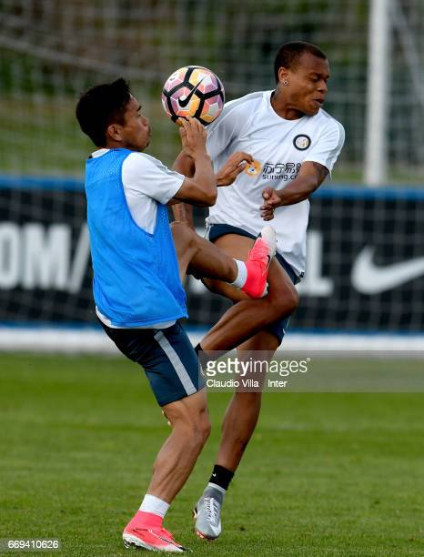 Yuto Nagatomo and Jonathan Biabiany compete for the ball during FC Internazionale training session at Suning Training Center at Appiano Gentile on...