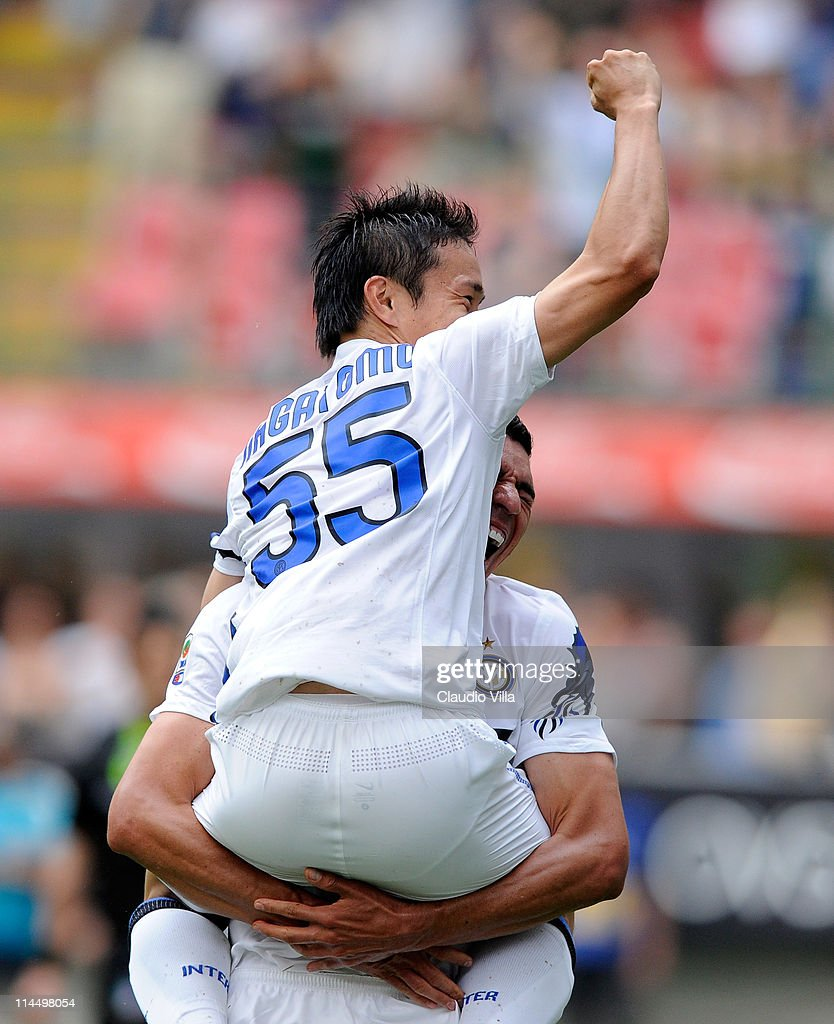 Yuto Nagatomo and Lucio of FC Inter Milan celebrates scoring the third goal during the Serie A match between FC Internazionale Milano and Catania Calcio at Stadio Giuseppe Meazza on May 22, 2011 in Milan, Italy.
