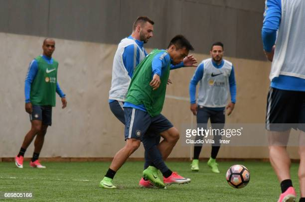 Yuto Nagatomo and Marcelo Brozovic of FC Internazionale compete for the ball during FC Internazionale training session at Suning Training Center at...