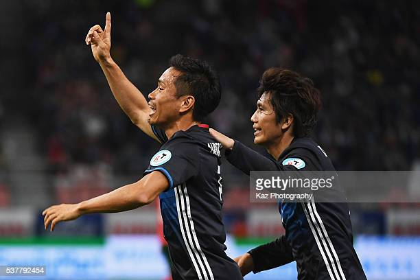 Yuto Nagatomo and Yosuke Kashiwagi of Japan celebrate their team's second goal by Shinji Kagawa during the international friendly match between Japan...