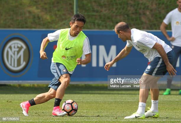 Yuto Nagatomo is challenged by Rodrigo Palacio during the FC Internazionale training session at the club's training ground 'La Pinetina' on April 11...
