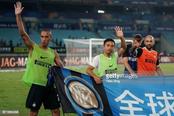 Yuto Nagatomo Miranda and Tommaso Berni of FC Internationale greet fans after the 2017 International Champions Cup football match between FC...
