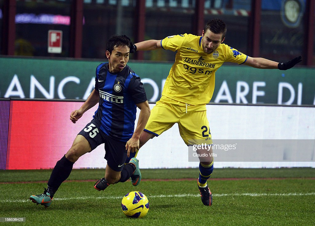 <a gi-track='captionPersonalityLinkClicked' href=/galleries/search?phrase=Yuto+Nagatomo&family=editorial&specificpeople=4320811 ng-click='$event.stopPropagation()'>Yuto Nagatomo</a> of FC Inter Milan #55 and Armin Bacinovic of Hellas Verona compete for the ball during the TIM Cup match between FC Internazionale Milano and Hellas Verona at San Siro Stadium on December 18, 2012 in Milan, Italy.