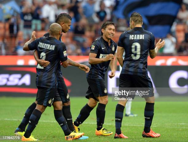 Yuto Nagatomo of FC Inter Milano celebrates scoring the first goal during the Serie A match between FC Internazionale Milano and Genoa CFC at San...