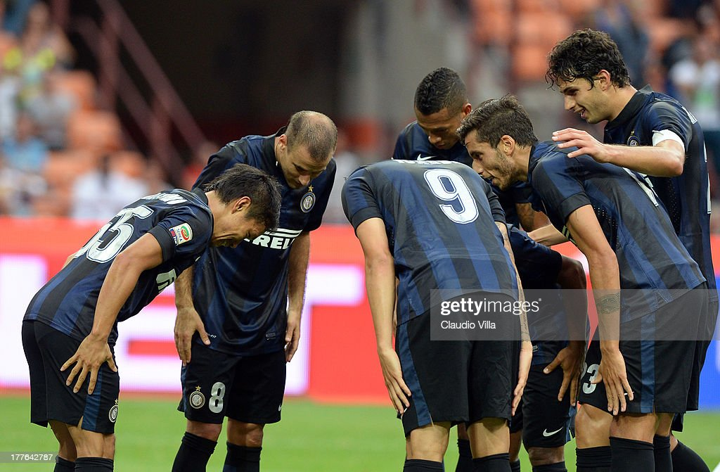 Yuto Nagatomo (L) of FC Inter Milano celebrates with his team-mates after scoring the first goal during the Serie A match between FC Internazionale Milano and Genoa CFC at San Siro Stadium on August 25, 2013 in Milan, Italy.