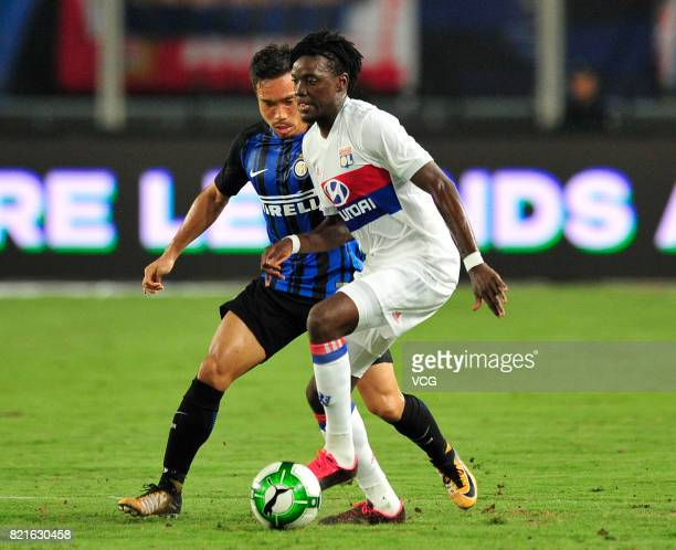 Yuto Nagatomo of FC Internazionale and Bertrand Traore of Lyon compete for the ball during the 2017 International Champions Cup match between FC...