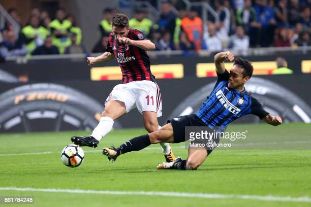 Yuto Nagatomo of FC Internazionale and Fabio Borini on Ac Milan in action during the Serie A match between FC Internazionale and AC Milan Fc...