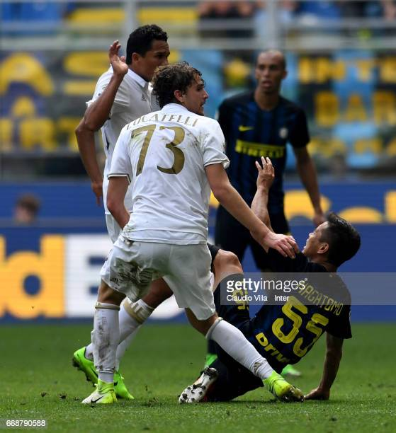 Yuto Nagatomo of FC Internazionale and Manuel Locatelli of AC Milan compete for the ball during the Serie A match between FC Internazionale and AC...