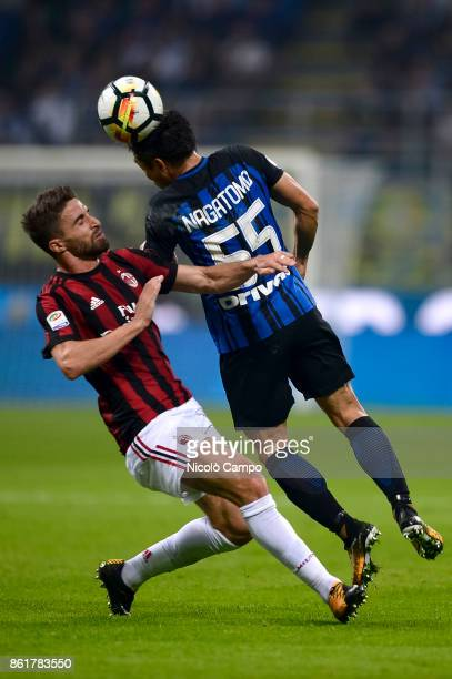 Yuto Nagatomo of FC Internazionale competes for a header with Fabio Borini of AC Milan during the Serie A football match between FC Internazionale...