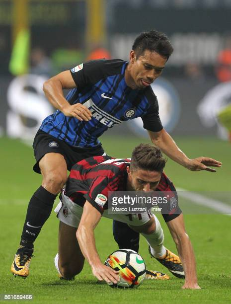 Yuto Nagatomo of FC Internazionale competes for the ball with Fabio Borini of AC Milan during the Serie A match between FC Internazionale and AC...