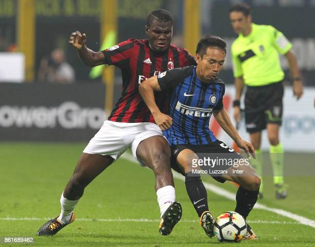 Yuto Nagatomo of FC Internazionale competes for the ball with Franck Kessie of AC Milan during the Serie A match between FC Internazionale and AC...