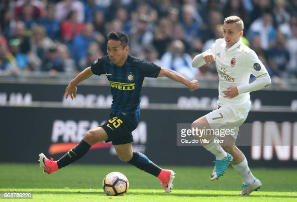 Yuto Nagatomo of FC Internazionale competes for the ball with Gerard Deulofeu of AC Milan during the Serie A match between FC Internazionale and AC...