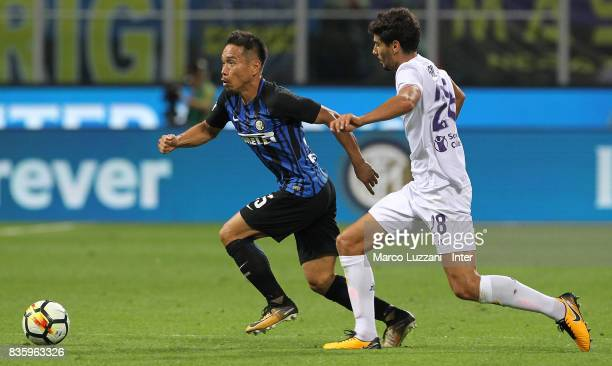 Yuto Nagatomo of FC Internazionale competes for the ball with Gil Dias of ACF Fiorentina during the Serie A match between FC Internazionale and ACF...
