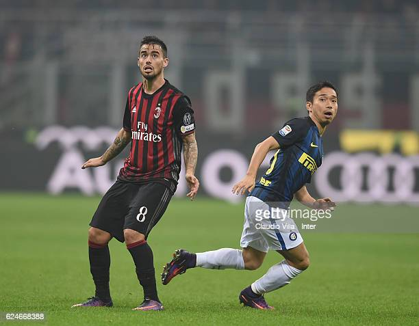 Yuto Nagatomo of FC Internazionale competes for the ball with Fernandez Suso of AC Milan during the Serie A match between AC Milan and FC...