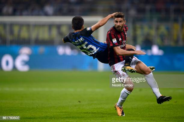 Yuto Nagatomo of FC Internazionale competes with Fabio Borini of AC Milan during the Serie A football match between FC Internazionale and AC Milan FC...