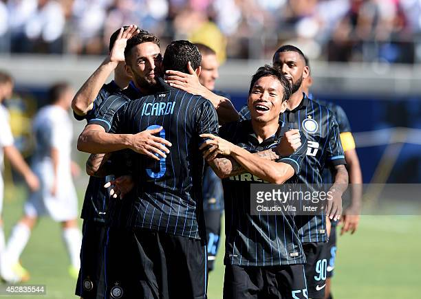 Yuto Nagatomo of FC Internazionale congratulates Mauro Icardi after Icardi made the last penalty kick to beat Real Madrid in a penalty shootout...