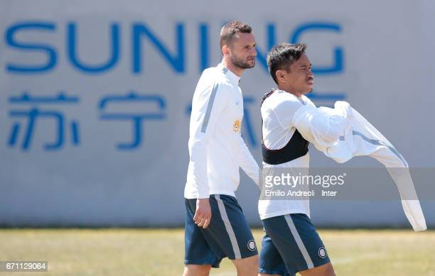 Yuto Nagatomo of FC Internazionale Milano and his teammate Marcelo Brozovic look on during the FC Internazionale training session at the club's...