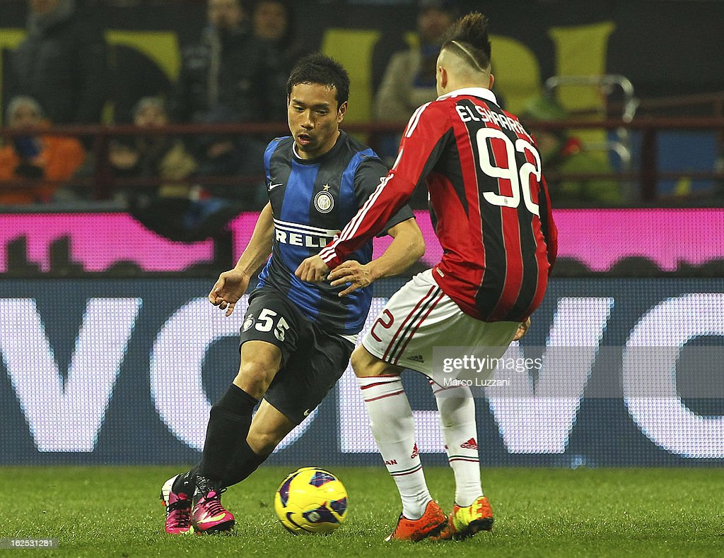 Yuto Nagatomo of FC Internazionale Milano competes for the ball with Stephan El Shaarawy of AC Milan during the Serie A match FC Internazionale Milano and AC Milan at San Siro Stadium on February 24, 2013 in Milan, Italy.