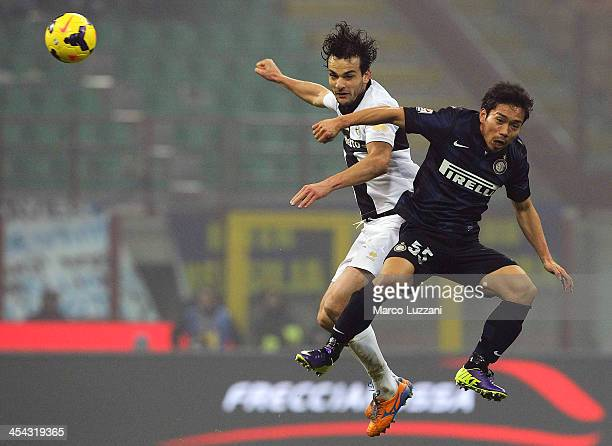 Yuto Nagatomo of FC Internazionale Milano competes for the ball with Marco Parolo of Parma FC during the Serie A match between FC Internazionale...
