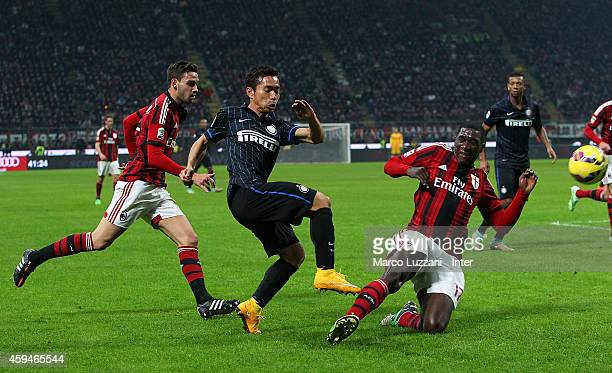 Yuto Nagatomo of FC Internazionale Milano competes for the ball with Cristian Zapata of AC Milan during the Serie A match between AC Milan and FC...
