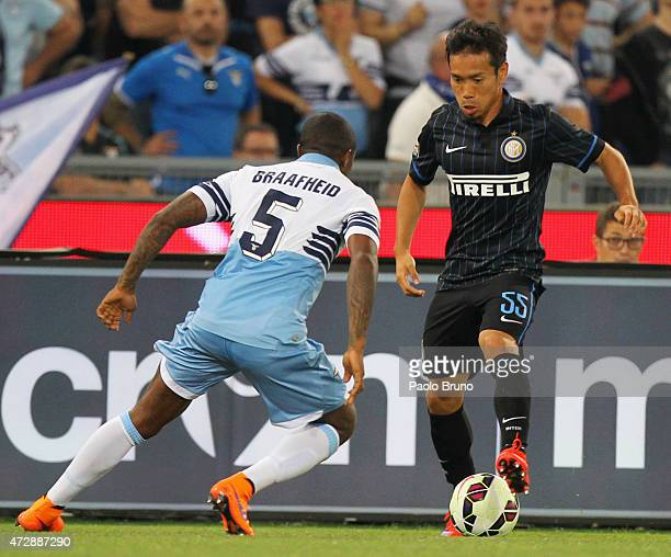 Yuto Nagatomo of FC Internazionale Milano competes for the ball with Edson Braafheid of SS Lazio during the Serie A match between SS Lazio and FC...