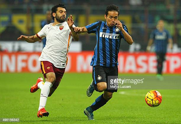 Yuto Nagatomo of FC Internazionale Milano competes for the ball with Mohamed Salah of AS Roma during the Serie A match between FC Internazionale...
