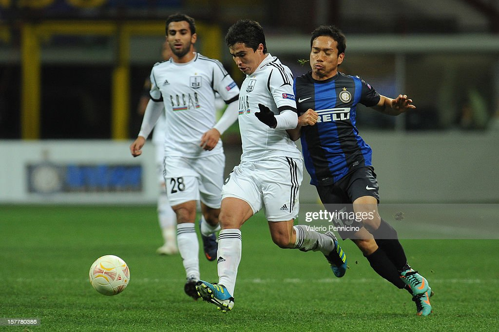 Yuto Nagatomo (R) of FC Internazionale Milano competes with Eric Ramos of Neftci PFK during the UEFA Europa League group H match between FC Internazionale Milano and Neftci PFK on December 6, 2012 in Milan, Italy.