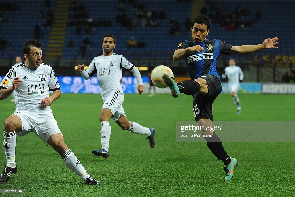 <a gi-track='captionPersonalityLinkClicked' href=/galleries/search?phrase=Yuto+Nagatomo&family=editorial&specificpeople=4320811 ng-click='$event.stopPropagation()'>Yuto Nagatomo</a> (R) of FC Internazionale Milano in action during the UEFA Europa League group H match between FC Internazionale Milano and Neftci PFK on December 6, 2012 in Milan, Italy.