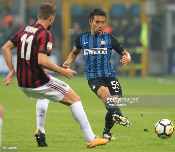 Yuto Nagatomo of FC Internazionale Milano is challenged by Fabio Borini of AC Milan during the Serie A match between FC Internazionale and AC Milan...